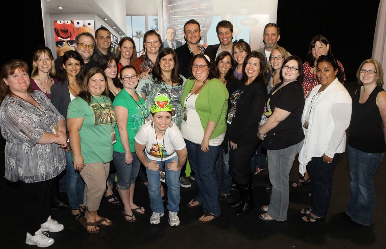 "Jason Segel and Nicholas Stoller (center back) and with Disney's ""mommy and daddy"" bloggers in LA"