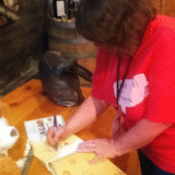 Writer Molly Wigand graciously autographs her book for me